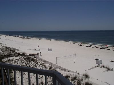 A view of the beach and volleyball court from your balcony.