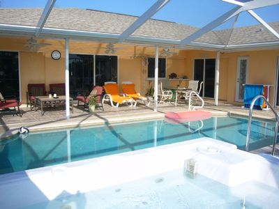 Huge covered lanai and pool deck, spa, grill, loungers, tables