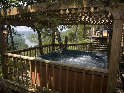 view from the hot tub deck to the main deck and river