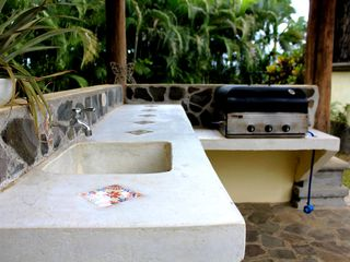 Playa Hermosa house photo - Pool side BBQ with inlaid handmade tiles in poured concrete.