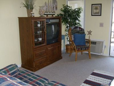 Comfy family room has sleeper/sofa and entertainment center! New Hardwood Floor!