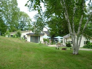 The back yard looking toward patio and campfire ring
