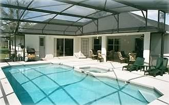 Very large Pool and Spa, with patio seating for twelve.