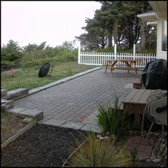 Moclips townhome photo - Patio on ocean side with picnic tables and gas barbecue.