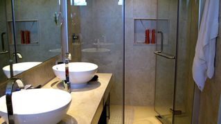 Tulum condo photo - Beautiful bathrooms--one in each of the 3 bedrooms.