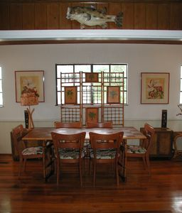 The dining room is in the front of the house and seats six in vintage comfort