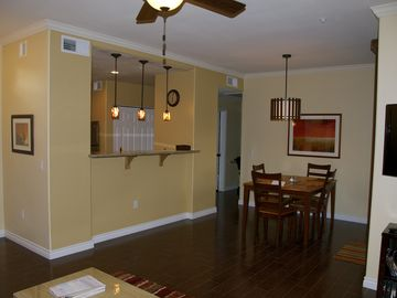Other Scottsdale Properties condo rental - Living room/dining room with beautiful wood tile floors and designer lighting.