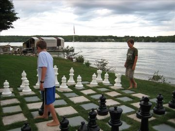 Chess on the lawn on a summer evening. Walloon Lake Country Club is behind.