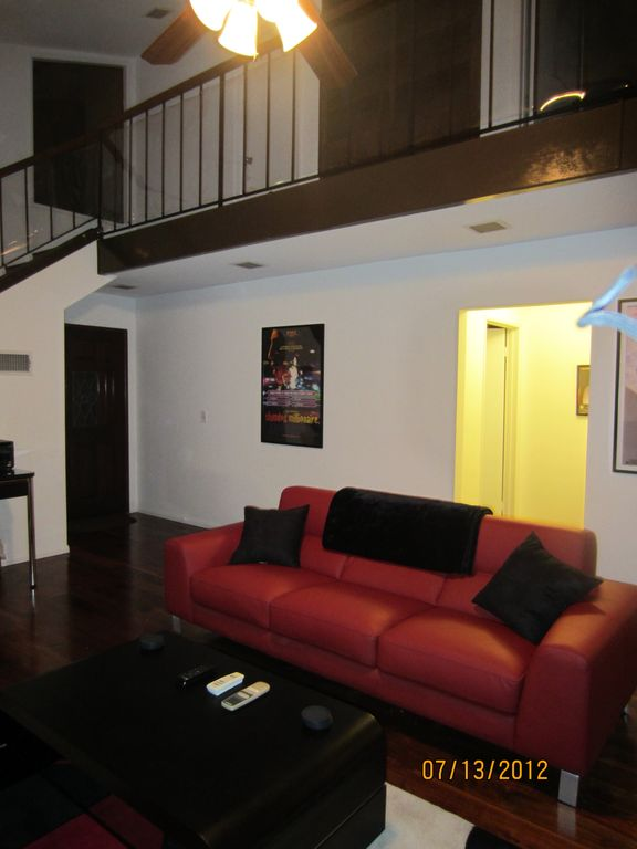 Living room, reverse angle, with overhead balcony.