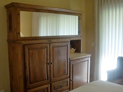 Armoire cabinet with TV and mini bar in bedroom 2