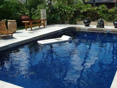 Swim and relax by your own beautiful ocean blue tiled pool
