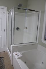 Folly Beach townhome photo - Master bathroom shower with rain-style shower head - perfect relaxation