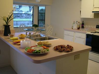 Easterly facing, eat-in kitchen that faces formal dining with canal view.