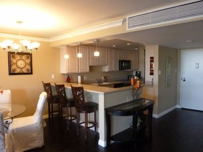 Full kitchen with upgraded appliances and crystal pendant bar lighting
