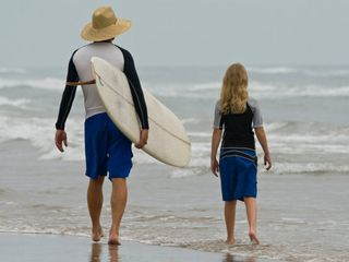 The island is about lazy afternoons, surfing, fishing & spending time together. - Corpus Christi condo vacation rental photo