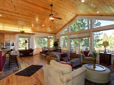 Well-designed great room with vaulted ceilings, pine log accents, fireplace