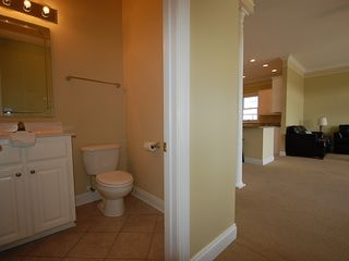 Fort Morgan property rental photo - This powder room is just off the living room on the second floor.