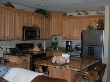 SS Bosch appliances and granite counters