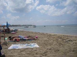 Pachino villa photo - .Sun bathing on the warm sandy beach.