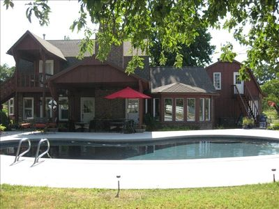 Fun country farm house with a very inviting swimming pool. Large covered patio.