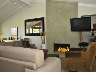 Palm Springs house photo - Warm fire-on-glass fireplace and large HDTV above. Living room area seats 9.