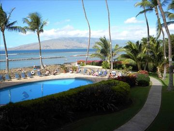 Swimming pool with West Maui in background.