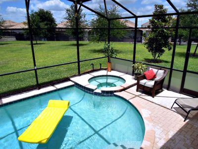 Sunny heated pool and lanai with huge, flat back yard.  Outdoor speakers and spa