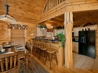 Pigeon Forge cabin photo - Kitchen totally open to the main living for plenty of socializing!