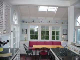 Bodega Bay cottage photo - Kitchen and dining area with door to deck on right