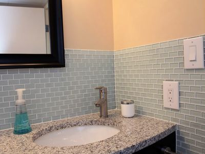 Newly renovated bathroom, includes towels and hair dryer
