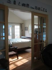 Wiscasset cottage photo - Master bedroom overlooking the water.