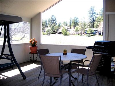 Back patio with gorgeous golf course & mountain views all around!