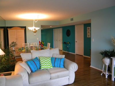 Notice the beautiful wood floors throughout the entire condo's living areas.