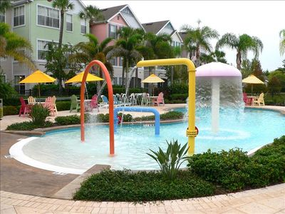 Playful water features for children at zero-entry end of family pool