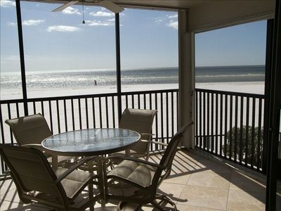Step down from the lanai screen door to the beach.