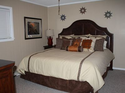 The Master Bedroom has a new King-size bed and Large Dresser and TV.