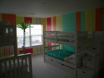 Super fun kids room that will sleep six! Additional storage cabinets under steps