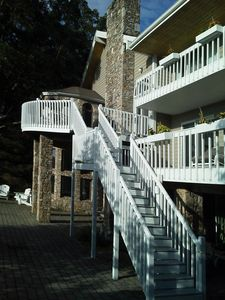 Recent upgrades include stairs to the multiple decks with great long range views
