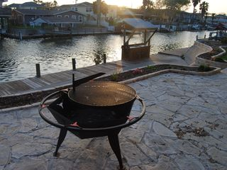 Rockport house photo - CLOSE UP OF FIREPIT, FISH CLEANING STN, Private Dock and Canal