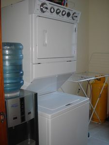 water cooler, washer/dryer and drying rack