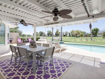 Palm Desert house rental - Outdoor Dining - Get even closer to the view at this 6-person dining table, kept cool by outdoor fans.