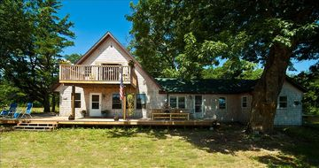 Beaver Island house rental - FRONT VIEW OF THE CEDER SHAKE HOUSE WITH SURROUND DECK AND UPSTAIRS BALCONY