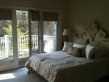 Master Bedroom w/ queen bed, walk in closet & deck overlooking Chauncey Creek