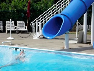 The community has an Olympic Sized pool with huge water slide