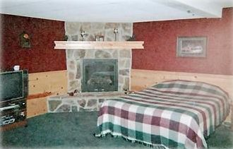 The Lower Level Walkout Bunkhouse with GAS FIREPLACE, TV, & Games (sleeps 7!)