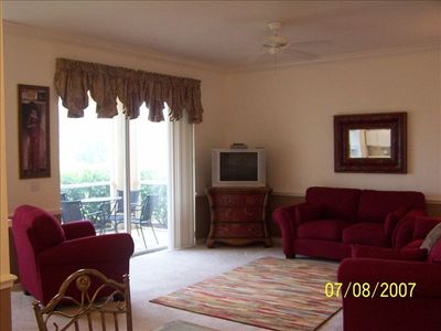 Living room, tastefully decorated, direct access to the lanai