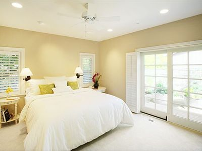Master bedroom, first floor, with private bath and view of garden