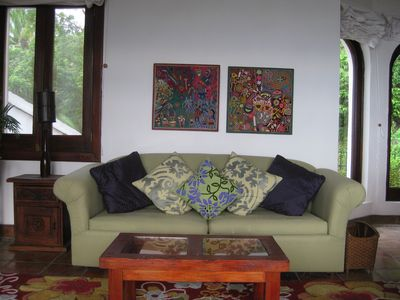 Living room with Huichol paintigs. Queen sized fold-out bed if needed,ocean view
