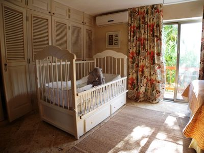 Downstairs bedroom wth double Queen and child's bed