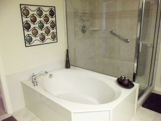 Vanderbilt Beach condo photo - Enjoy Soaking in the Tub With Your Favorite Book!